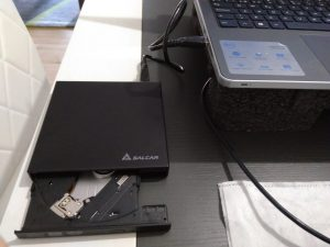 Connected the external odd portable drive with the USB cable to the laptop